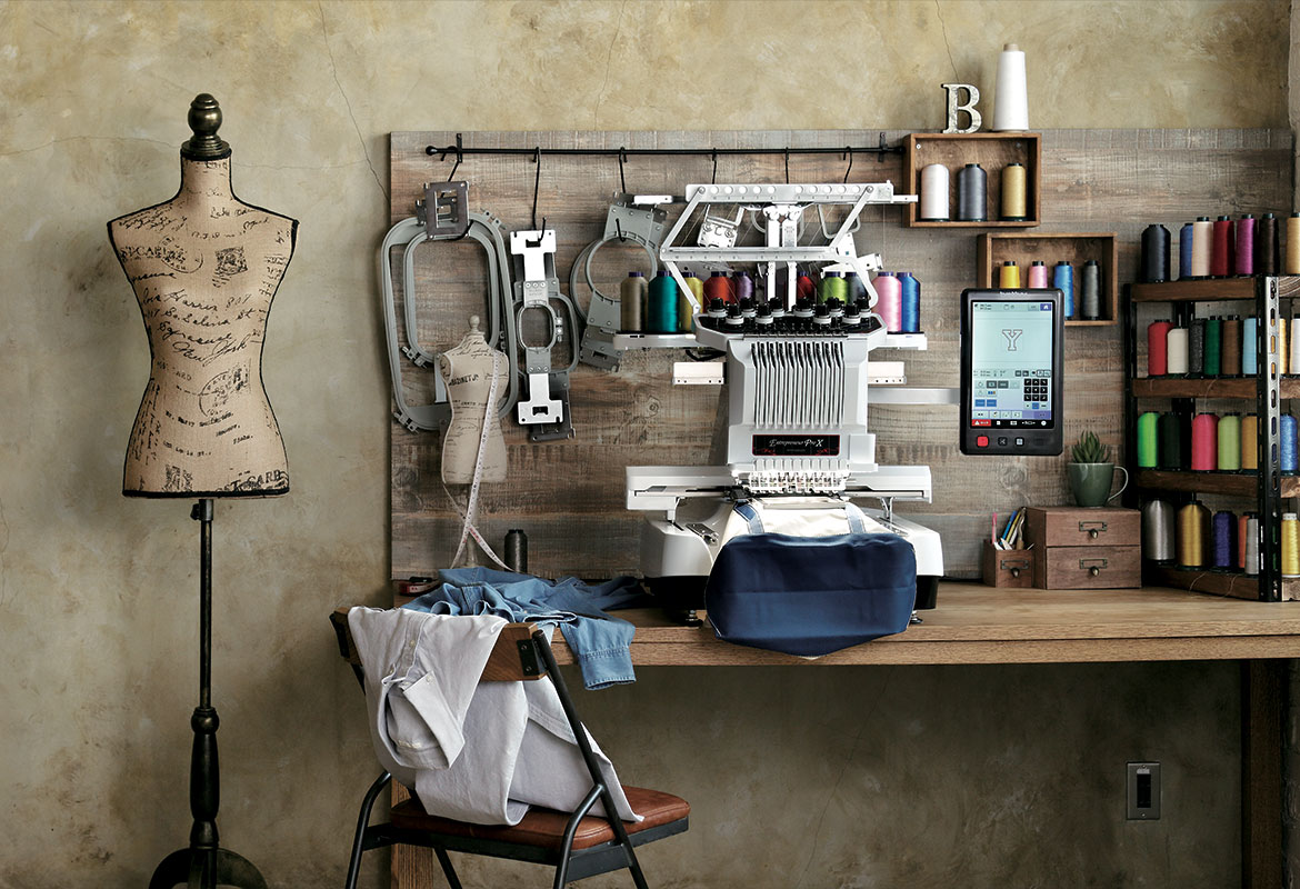 PR embroidery machine in shop setting with mannequin and frames