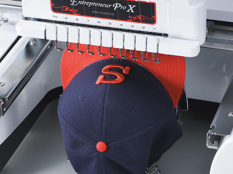 Blue and red cap in embroidery machine