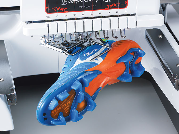 Blue and red shoe in embroidery machine